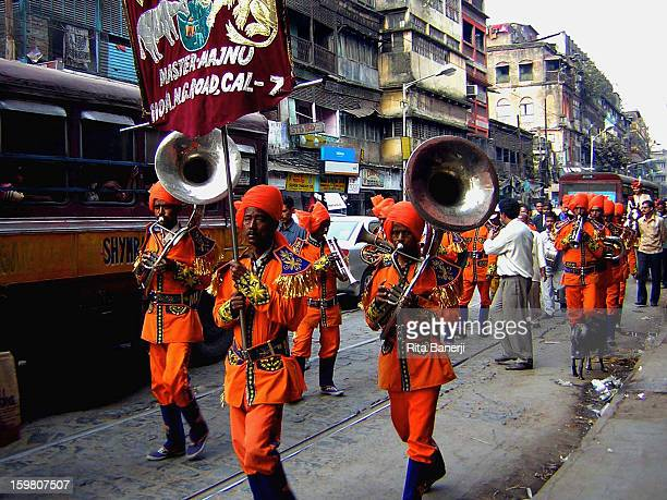 Small musical bands pave the way through the busy traffic, to announce the arrival of the groom and his relatives at weddings in India. The groom is...