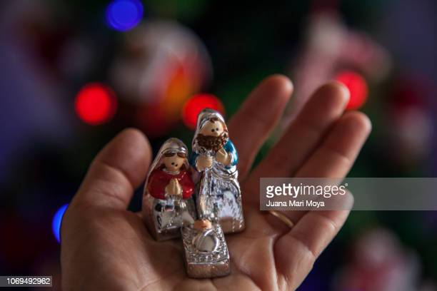 small nativity scene in a hand - nativity stock photos and pictures