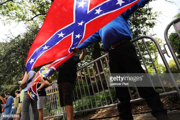 A small number of proconfederate supporters face off against hundreds of demonstrators against a Confederate memorial monument in Fort Sanders as...
