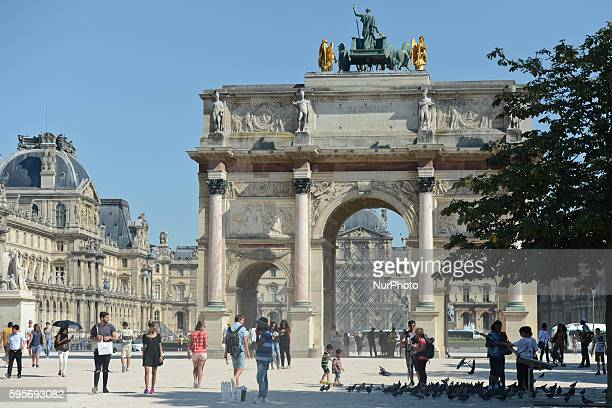Small number of tourists near the Arc de Triomphe du Carrousel and in front of the Louvre Museum as fewer foreign tourists visit the French capital...