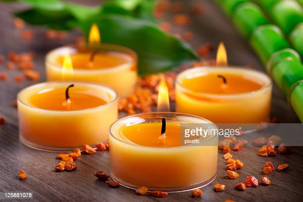 Small orange candles and stones with bamboo decoration