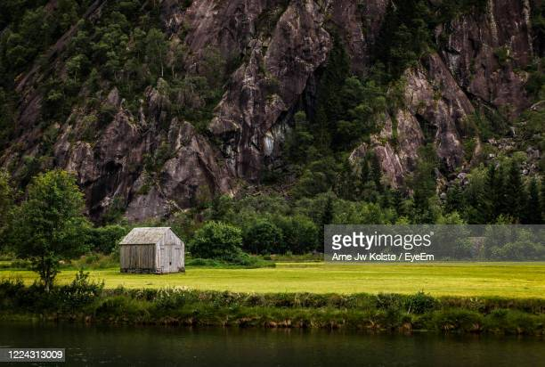 small outhouse in a valley in west norway. - arne jw kolstø stock pictures, royalty-free photos & images