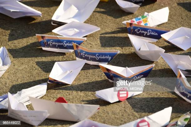 A small paper boats are picured in front of piazza della Scala in Milan on June 27 2018 during a flashmob organized simultaneously in many European...
