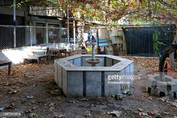 small park with marble fountain closed after covid restrictions. - emreturanphoto stock pictures, royalty-free photos & images