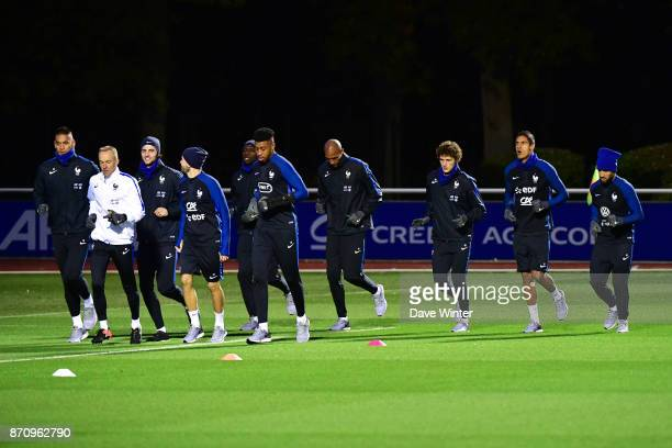 A small part of the squad go for a jog during the training session at the Centre National de Football in Clairefontaine en Yvelines France on...
