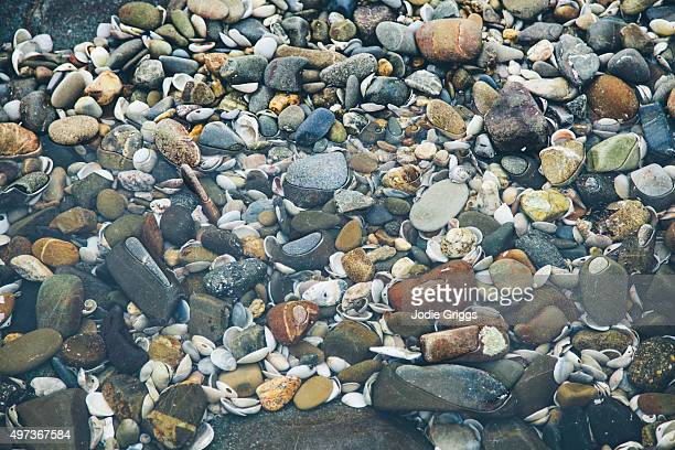 Small pebbles in tidal pool covered by sea water