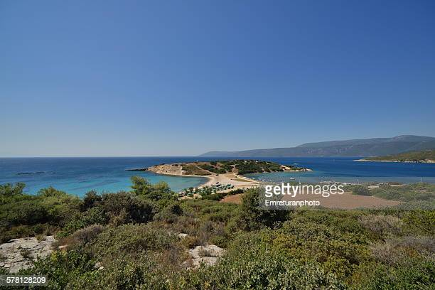 small peninsula with beach and fishermen's shelter - emreturanphoto stock pictures, royalty-free photos & images