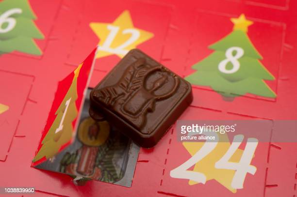 ILLUSTRATION A small piece of chocolate pictured next to the first opened door of an Advent calendar inSieversdorf Germany 24 November 2015 Photo...