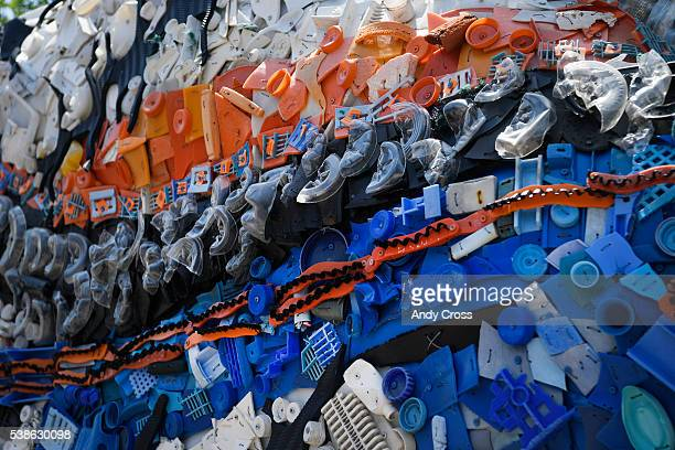 Small pieces of plastic trash collected from the sea adorn the side of the Rufus the Triggerfish sculpture at the Denver Zoo June 07 2016 The...