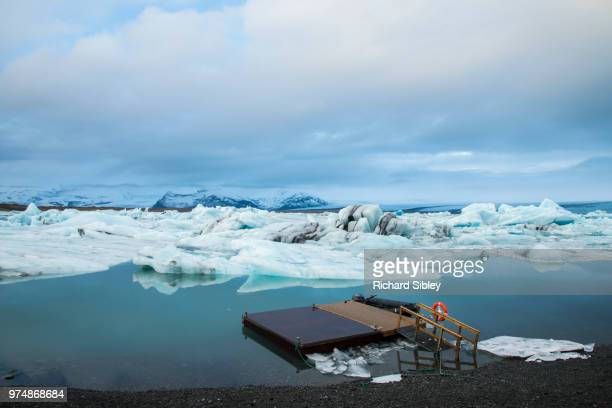 a small pier on a glacial lagoon. - sibley stock photos and pictures