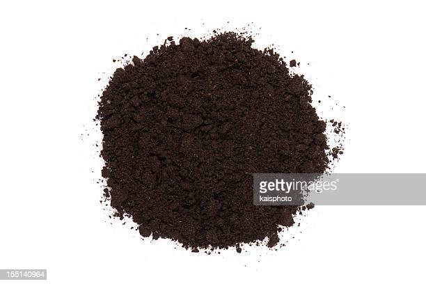small pile of dark compost soil on white - heap stock pictures, royalty-free photos & images