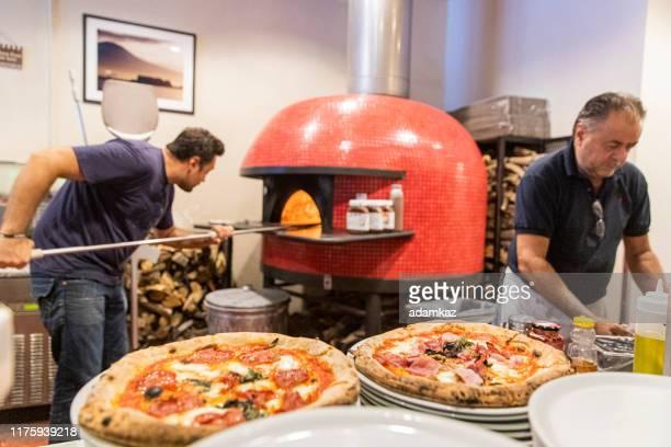 small pizzeria kitchen - pizzeria stock pictures, royalty-free photos & images