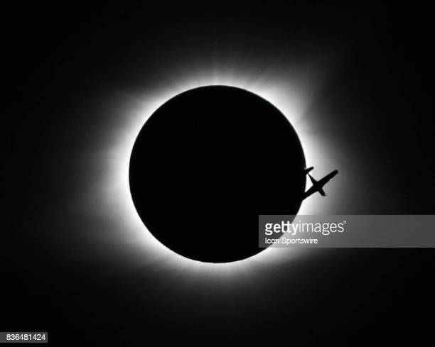 A small plane is silhouetted by the eclipse as it flies thru the path of totality on August 21 2017 in Saluda South Carolina