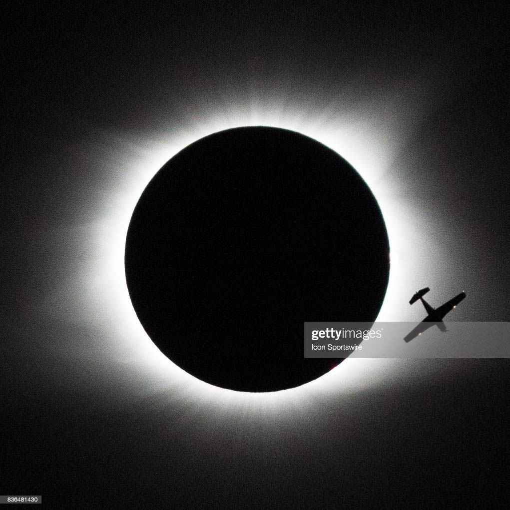 A small plane is silhouetted by the eclipse as it flies thru the path of totality on August 21, 2017 in Saluda, South Carolina.
