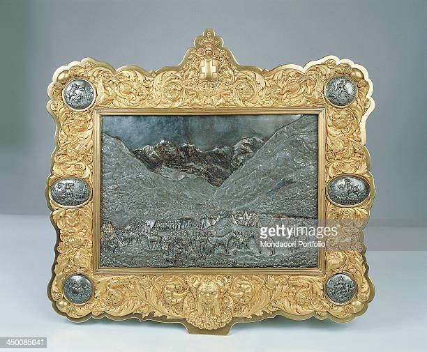 Small plate by Rinzi Giovanni 19th Century embossed steel damascened in gold and niello embossed and goldplated copper frame