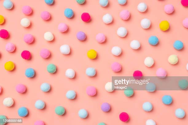 small pom-pom balls spotted pattern - wool stock pictures, royalty-free photos & images