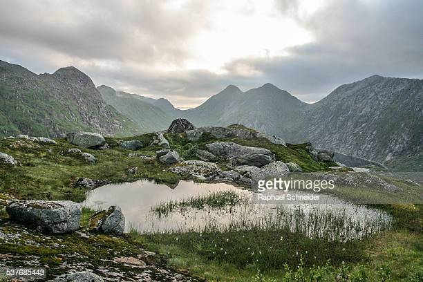 Small pond under dramatic sky, Norwegian mountains