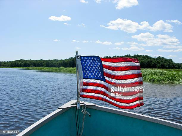 Small powerboat with US flag