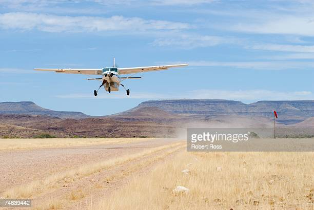 small private plane taking off - airfield stock pictures, royalty-free photos & images