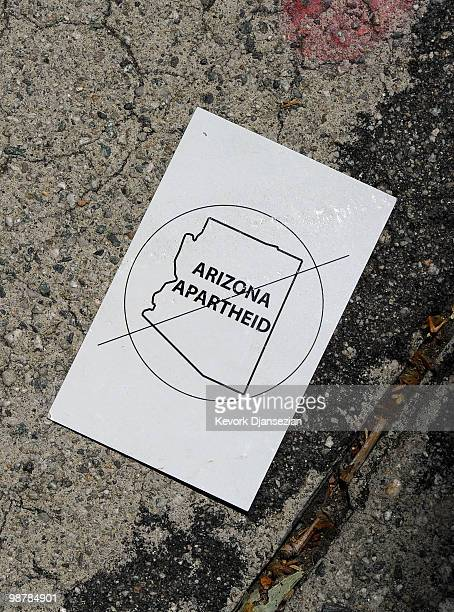 A small protest sign is seen on the asphalt as thousands of demonstrators march during a May Day immigration rally on May 1 2010 in Los Angeles...