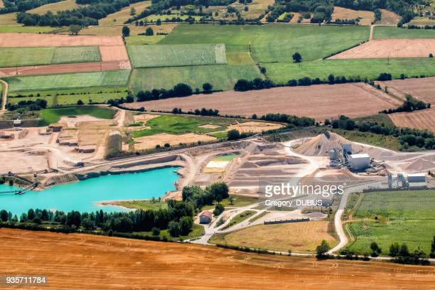 small quarry industry with sand and gravel stack aerial view in middle of nature - ain france stock pictures, royalty-free photos & images
