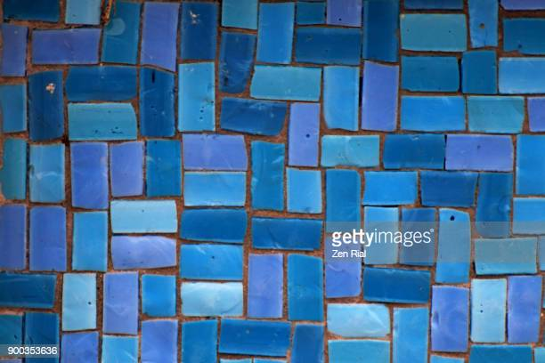 small rectagular ceramic tiles in different tones of blue - mosaic stock photos and pictures