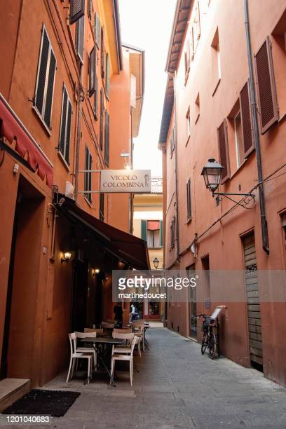 """small restaurant in the narrow streets of bologna, italy. - """"martine doucet"""" or martinedoucet stock pictures, royalty-free photos & images"""