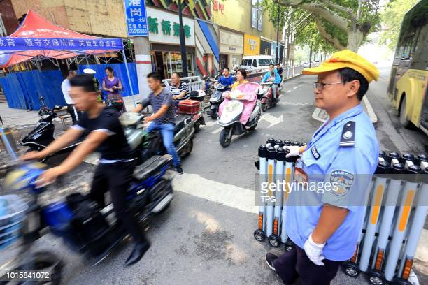 A small retractable door was set to stop people run the red light on 12 August 2018 in ZhengzhouHenan China