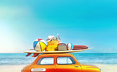 Small retro car with baggage, luggage and beach equipment on the roof, fully packed, ready for summer vacation, concept of a road trip with family and friends, dream destination, very vivid colors with dominant blue sky and ocean and bright orange car.
