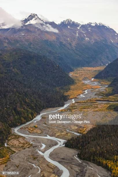a small river flowing in a valley in the kenai mountains - kenai mountains stock pictures, royalty-free photos & images