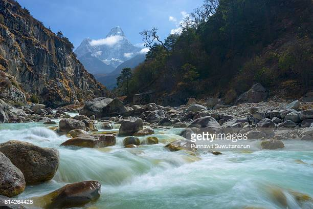 Small river in front of Ama Dablam mountain, Everest region