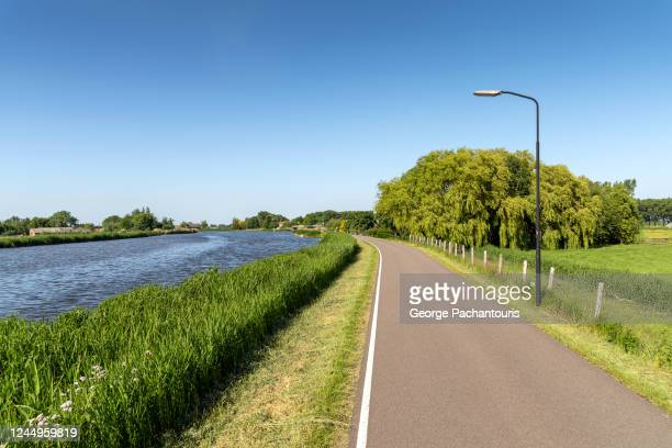 small road next to the river - gelderland stock pictures, royalty-free photos & images