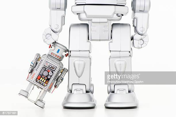 Small robot leaning against taller robot