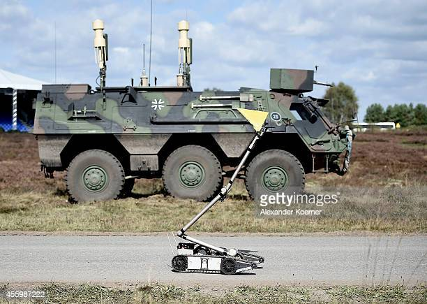 A small robot of the Bomb Squad of the German armed forces stands in front a transport vehicle `Fuchs` during the annual military exercises at the...