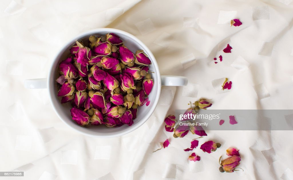 small rose tea flowers in a cup stock photo getty images