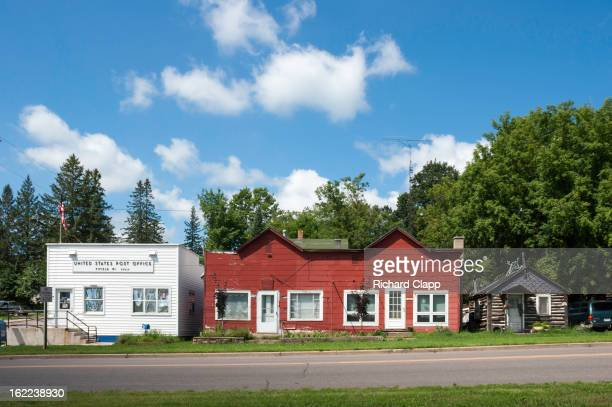 Small rural post office, duplex and log cabin on Highway 13 in Northern WI.