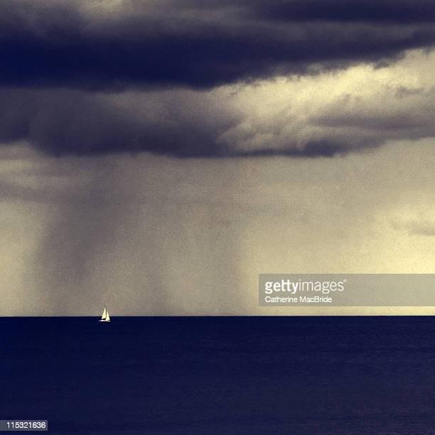 small sail boat in stormy weather - catherine macbride foto e immagini stock