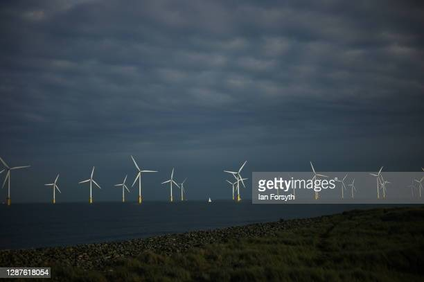 A small sailing boat passes the EDF energy offshore wind farm near Redcar on November 25 2020 in Redcar England