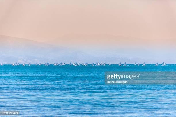 small sailing optimist boats gathered near cesme at izmir gulf bay Turkey