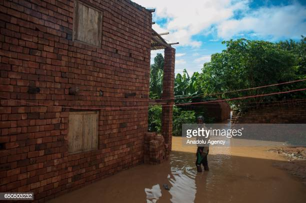 Small scaled flood takes place after the tropical cyclone Enawo in Antananarivo Madagascar on March 9 2017 Red Cross staff gave food aid to victims...