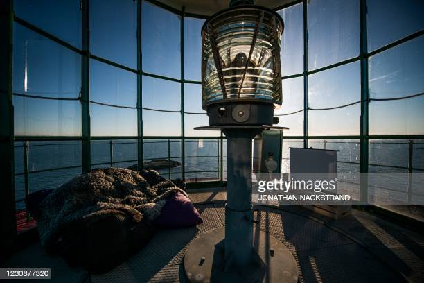 Small screen is placed inside the Pater Noster lighthouse on the island of Hamneskar off Sweden's west coast, on January 30 north west of Gothenburg....