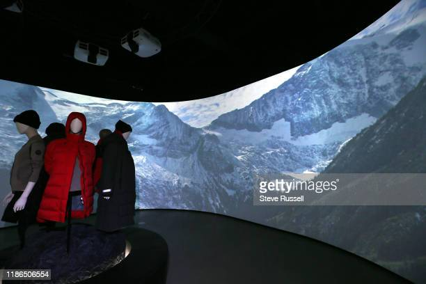 Small selection of Canada Goose clothing is on display in a panoramic room that takes the viewer on a trip through mountains. Luxury parka maker...