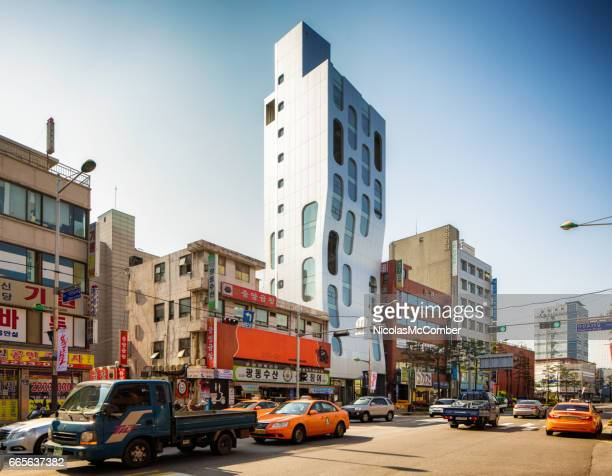 Small Seoul South Korea street with modern apartment building and traffic