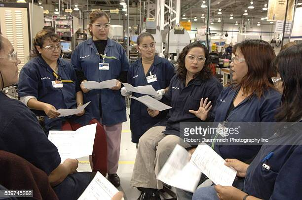 A small 'shift meeting' where employess discuss the day's production at Delphi Delco Electronics de Mexico a maquiladora plant across the US border...