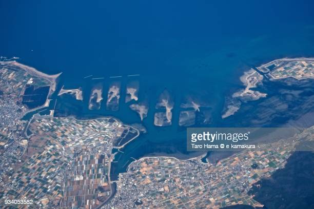 Small shoals in Atsumi peninsula in Tahara city in Aichi prefecture in Japan daytime aerial view from airplane
