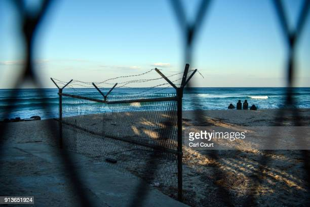 A small shooting range is positioned on a beach behind a barbed wire fence near the Korean Demilitarized Zone on February 3 2018 near Goseonggun...