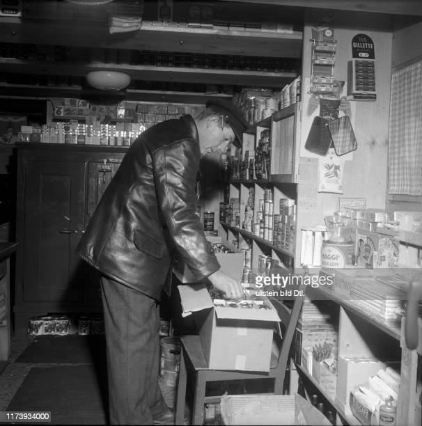 Small shop aboard of a ship Basle rhine port 1953