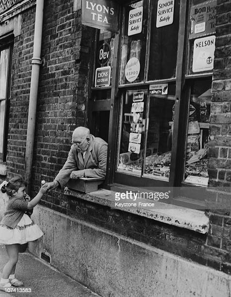 Small Shop Below Bethnal Green Flats In London On August 30Th 1960