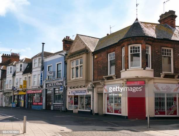 small shops in a side street in lowestoft, suffolk - fachada supermercado imagens e fotografias de stock