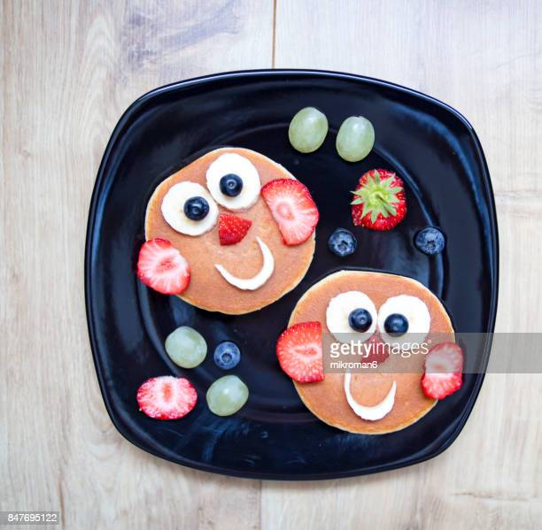 Small Smile face made with fresh fruits and pancakes. Fruit Art Recipe. Food art creative concepts.